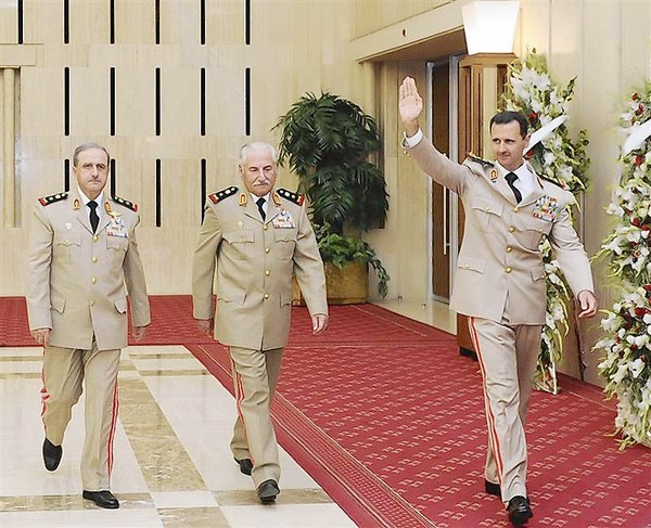 File photo of Syria's President Bashar al-Assad arriving for 65th army foundation anniversary dinner in Damascus (SANA, REUTERS / September 4, 2013)